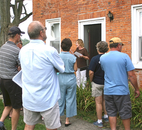 Linda Hodges talks to the group before giving them a tour of her 187-year-old home near Charloe. Judy Wells/Paulding County Progress